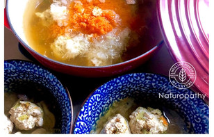Japanese hot pot: Cabbage chicken balls & grated daikon radish, carrot, and ginger.