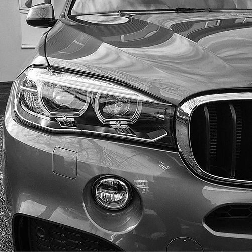 BMW X5M Close up front headlight