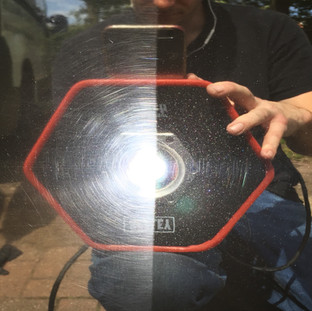 A 50-50 photo showing how machine polishing can remove scratches from paint while leaving it with a deep gloss finish.