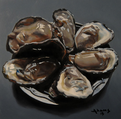 Oysters on a black plate.jpg