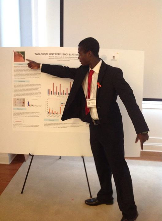 Pivot Zotamou, a 2014 scholarship award winner, won a research fellowship in San Diego. Here he presents his research at a local conference.