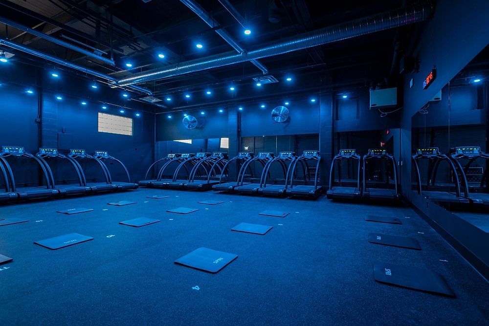 Fitness studio with treadmills and floor mats