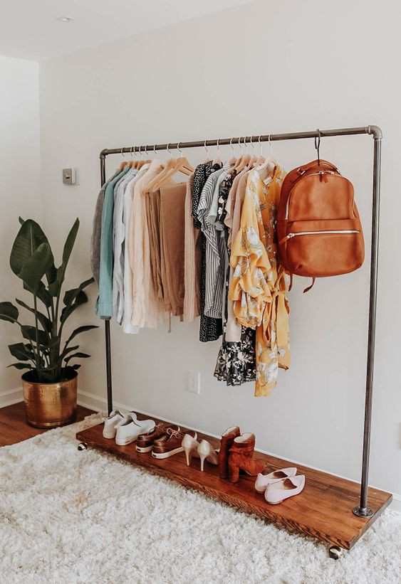 curated capsule wardrobe closet on rolling rack
