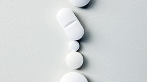 Why do pills taste so bitter?