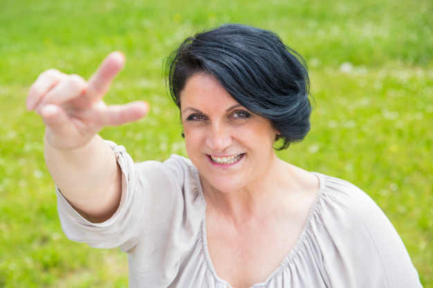 joyful-happy-middle-aged-woman-showing-p