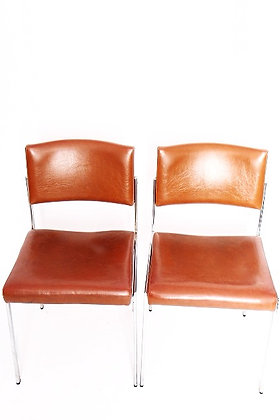 Paire de chaises en simili cuir