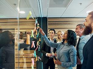 cheerful-entrepreneur-team-talking-in-th