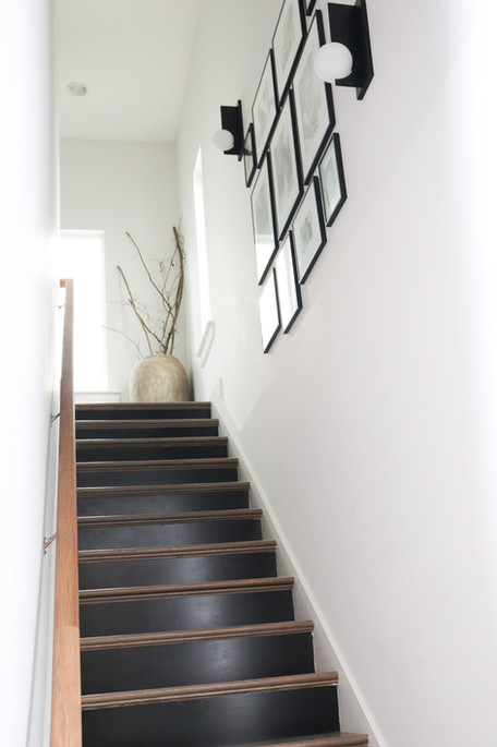 Black Stairs and gallery wall