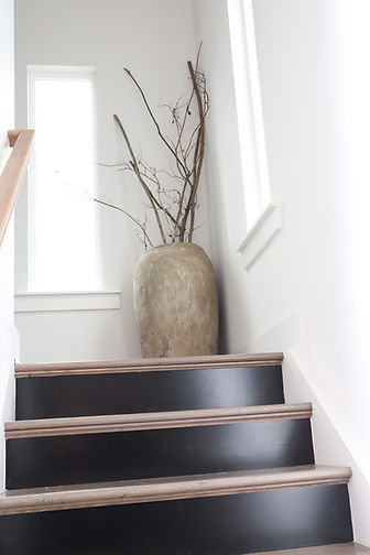 Matte Black Stairwell and Large Vessel