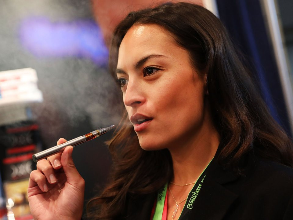 Jordan Michelle vapes a CBD oil made from hemp at the Cannabis World Congress Conference. Spencer Platt/Getty
