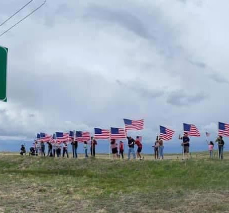 """Flag Line in support of the """"Remember Our Fallen"""" ride"""