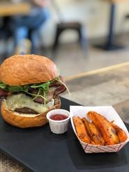Cajun burger with baked sweet potato fries