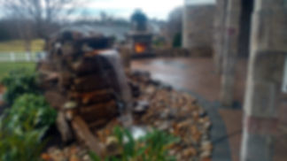 Outdoor living area, pondless waterfall, fireplace, paver patio installation, tandem wall