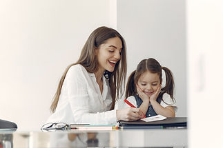 tutor-with-litthe-girl-studying-at-home.jpg