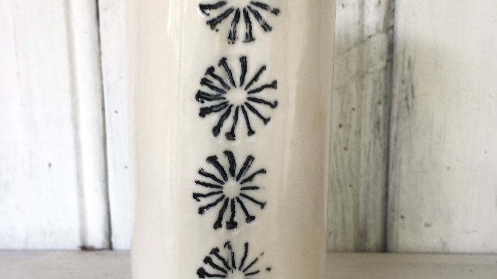 Porcelain vase with poppy seed head detail