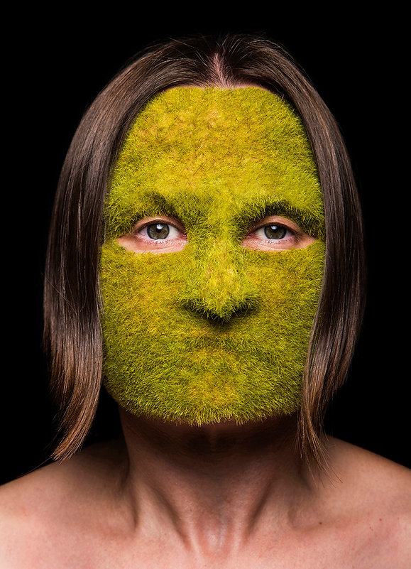 vacant (smother series) - a face covered in fake green grass to hide and mask identity