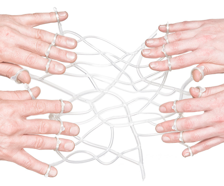 infuse (bind series) - the fingers of lovers hands linked by a network of translucent catheters