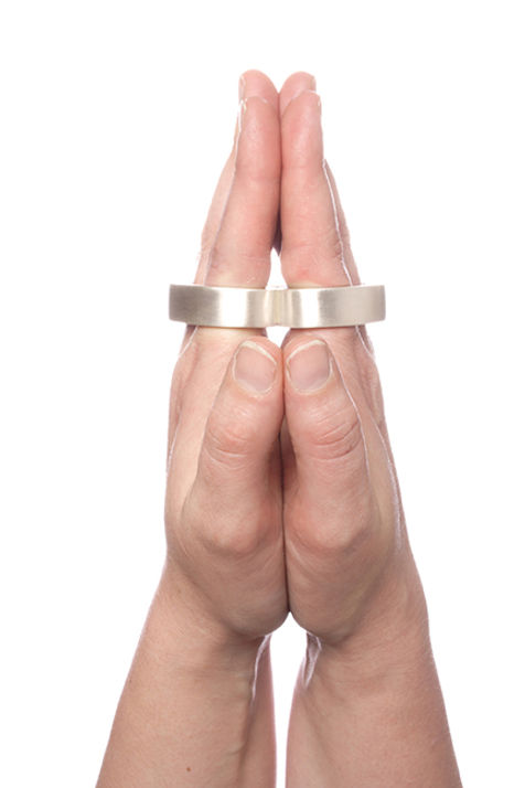 bound (from constrain series) - a sterling silver hand cuff which forces the hand into prayer position when worn