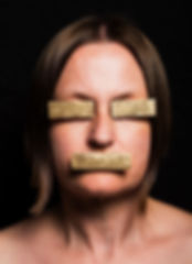 nullify (smother series) - the eyes and mouth on a face concealed by gold plates to hide and mask identity