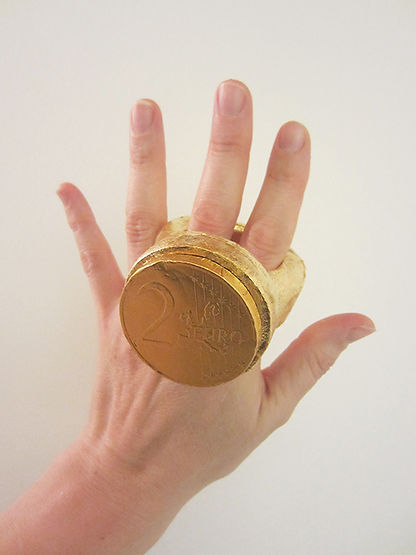 currency (gloss series) - an over sized gold plated ring stone set with a chocolate Euro coin