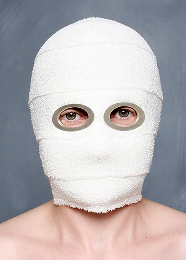 mask (cosmetic series) - a hood made from bandages with cut out sterling silver holes revealing the eyes, representing the healing process associated with cosmetic surgery