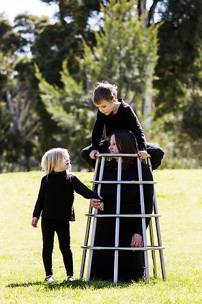 structure (smother series) - children playing on structure, a life size wearable playground climbing frame made from stainless steel