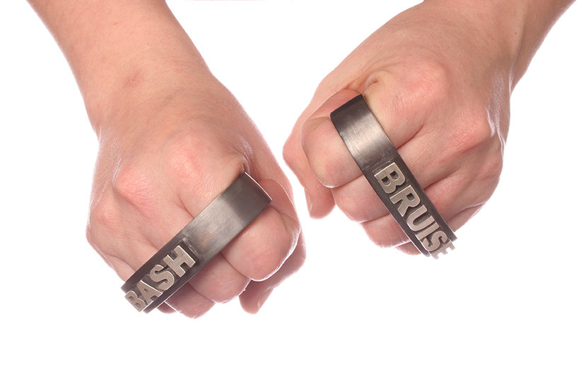 abash (from constrain series) - knuckledusters with the words 'bash' & 'bruise' on them made from sterling silver