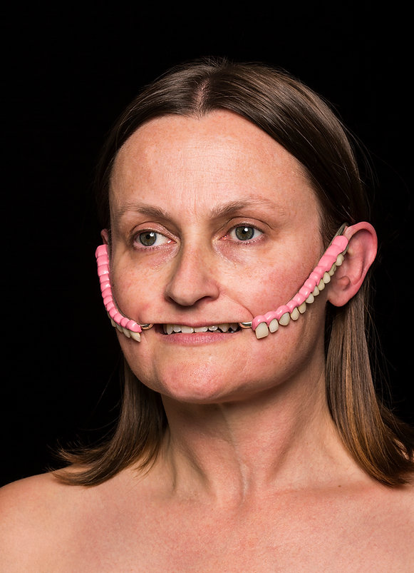 gnash (smother series) - a smile extender made from false teeth and sterling silver