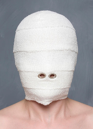 mask (cosmetic series) - a hood made from bandages with cut out sterling silver holes revealing the nostrils, representing the healing process associated with cosmetic surgery