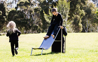 slope (smother series) - children playing on slope, a three quarter sized wearable playground slippery dip slide made from stainless steel