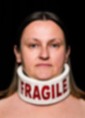 brace (smother series) - a collar neck brace made from crayon with the word fragile