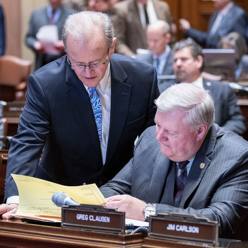 Much of our legislation requires crossing the aisle in working with others. In this case Limmer speaks with DFL Senator Greg Clausen.