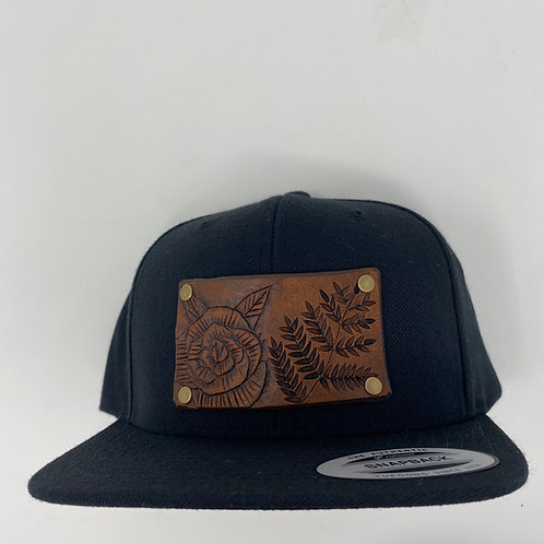 Leather patch snapback hat