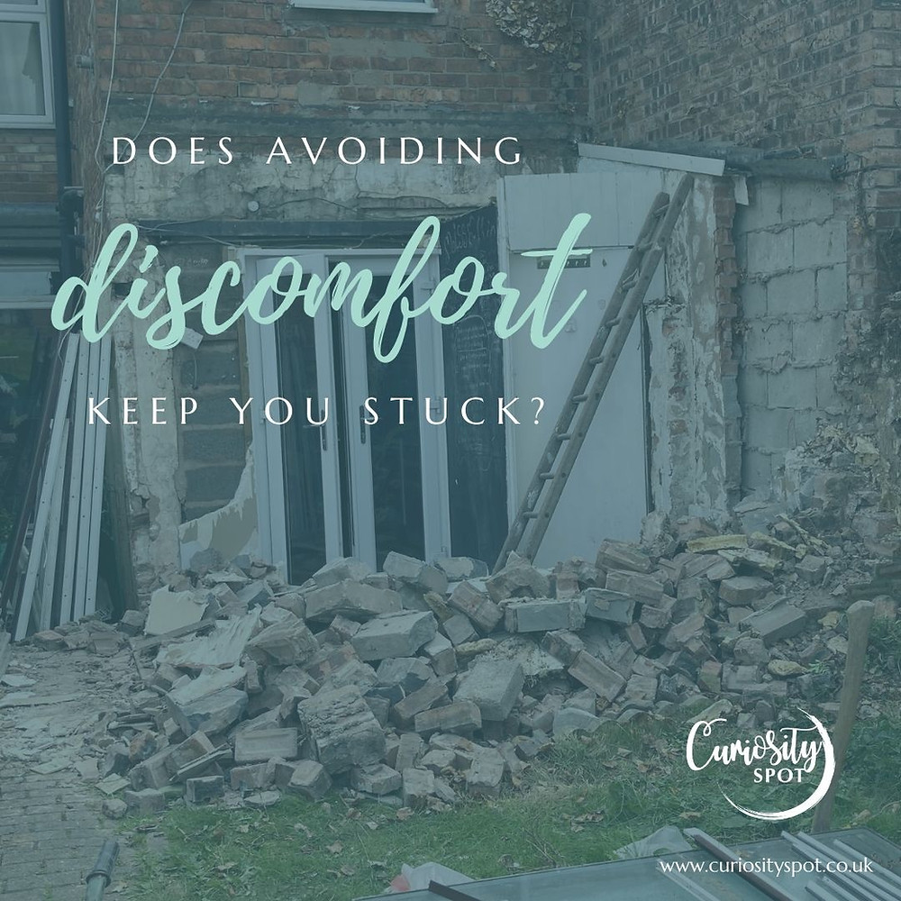 Back of a house where part of the building has been demolished. Piles of bricks are on the group and a ladder leans agains a wall. Test reads 'Does avoiding discomfort keep you stuck?'