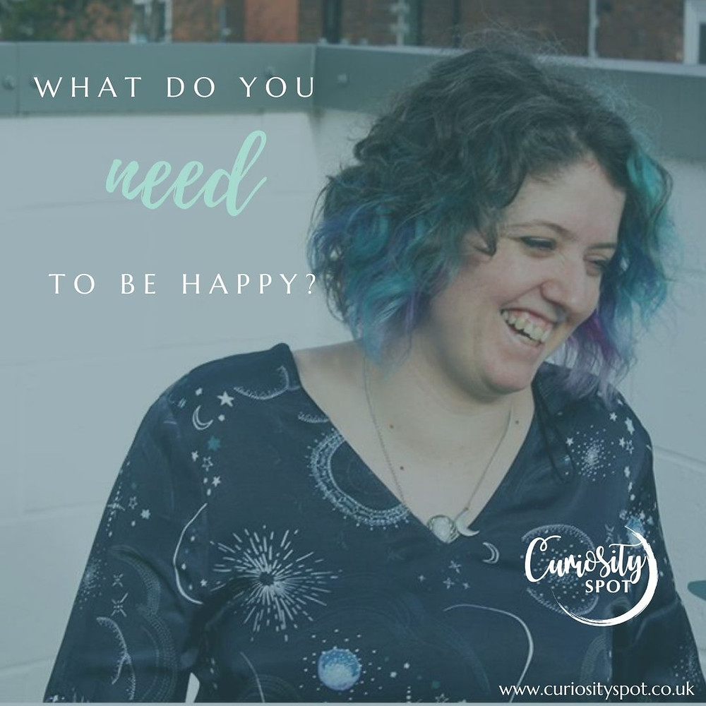 Louise is laughing, looking down and to the right. Text reads 'What do you need to be happy?. Curiosity Spot log and text reading www.curiosityspot.co.uk is in the bottom right corner.
