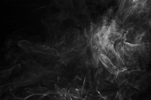smoke-swirling-around-against-black-back