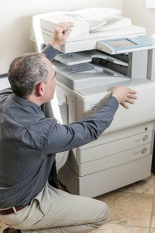 bigstock-business-man-opening-photocopy-