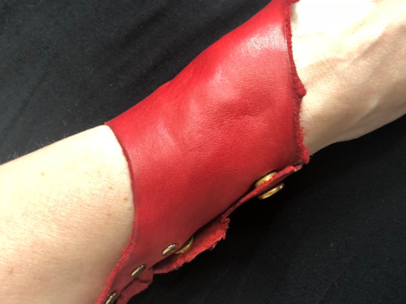 RED LEATHER WITH GOLD HARDWARE