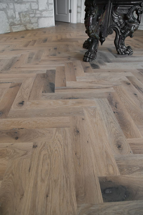 herringbone wood flooring close up view