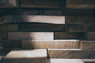 stacked raw wood samples