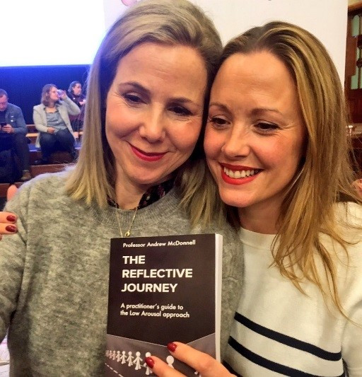 Sally Phillips (left) and Elly Chapple (right) with a copy of 'The Reflective Journey' by Professor Andrew McDonnell