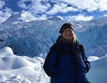 Rain standing in front of Portage Glacier smiling