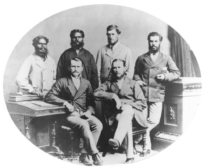 'Forrest expedition exploring party, 1874'.  Left to right, back row: Tommy Pierre, Tommy Windich, James Kennedy, James Sweeney; front row: Alexander Forrest, John Forrest.  Source: State Library of Western Australia, 004541D.