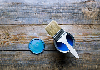 painting at home with can blue paint on