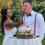 Couple Enjoying their Wedding Cake made