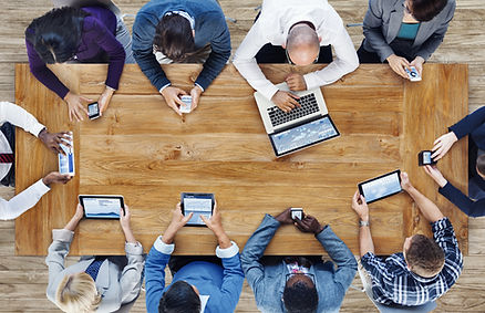 Group of Business People Using Digital D