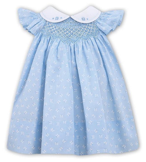 85389e8b18b33 Sarah Louise smock dress. This traditional style dress in blue with hand  smocking. It has a white butterfly design running through the fabric.