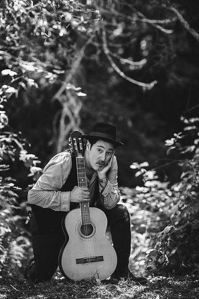 Jesse Kneeling Guitar.jpg