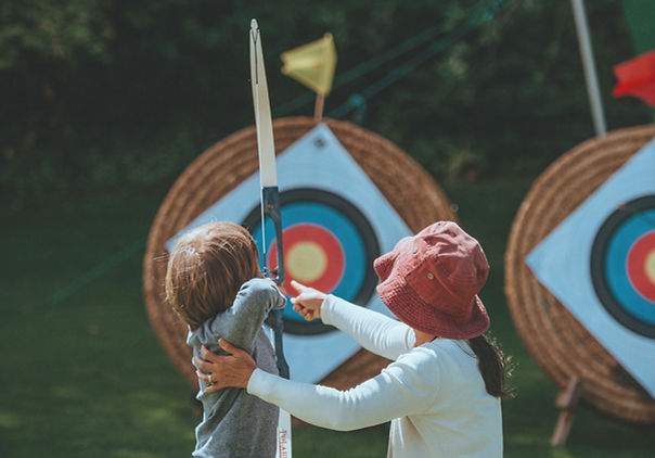 Mother & Child Shooting Arrows