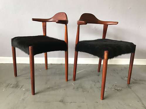 Pair of Teak Bullhorn Chairs with Cowhide Upholstery